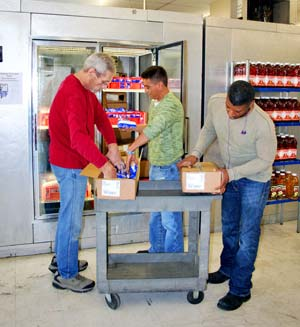 Food pantry volunteers restock items