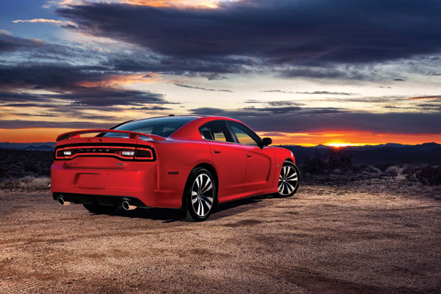 SEEING RED  |  You can have devilish fun with the high-powered sex appeal of the Mercedes AMG Coupe, top, or the muscle-car testosterone of the Dodge Charger, above. (Photos courtesy of Mercedes-Benz and Dodge)
