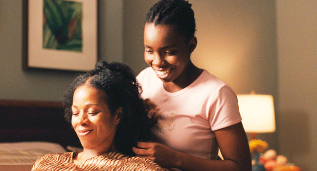 SHARE AND SHARE ALIKE  |  A closeted 17-year-old (Adepero Aduye, right) shares a moment with her clueless mom (Kim Wayans) in 'Pariah.'