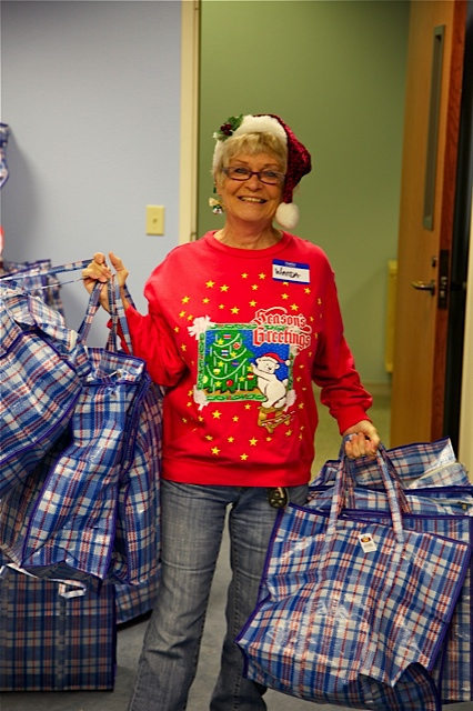 Volunteer Wanda Brown helps get ready for the Breakfast at Cathedral of Hope on Chirstmas Eve