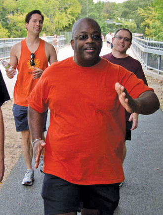 DFW Frontrunners members Steven, left, and Kevin, right, set the pace with new members like Moe, center, to powerwalk for fitness with the group when they meet every Saturday morning to hit the Katy Trail.