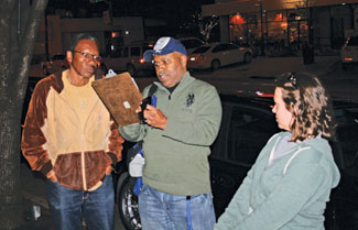 HUNTING THE HOMELESS | Promise House case managers Benjamin Williams, center, and Jessica Amspoker talk to Terry Fisher, a homeless man, on Cedar Springs last month. Promise House provides temporary emergency shelter for young homeless people, and Amspoker and Williams say older homeless people are often the best source of information about where to find youths on the streets. (David Webb/Dallas Voice)