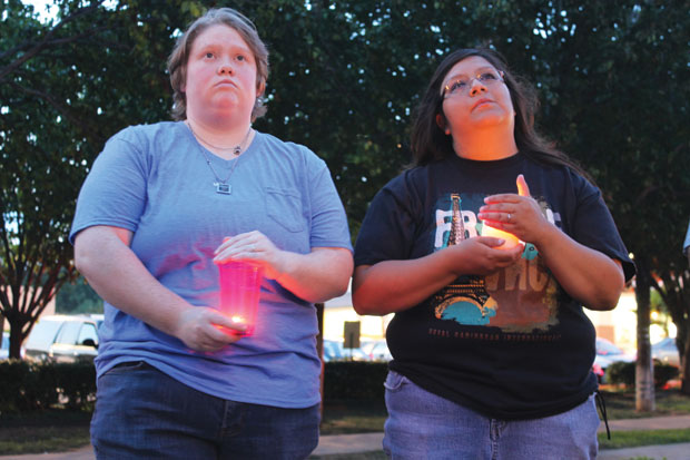 Participants hold candles as they listen to speakers Tuesday, May 22, during Dallas' first-ever Harvey Milk Day celebration at the Legacy of Love Monument. (John Wright/Dallas Voice)