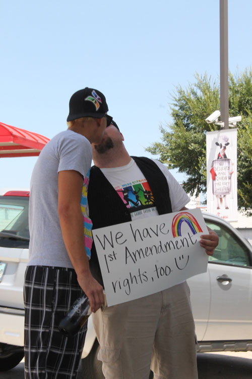 Couple Tyler Savage, left,  and Larry Farris kiss Friday, Aug. 3, at a Dallas Chick-fil-A for National Same-sex Kiss-in Day. (Anna Waugh/Dallas Voice)