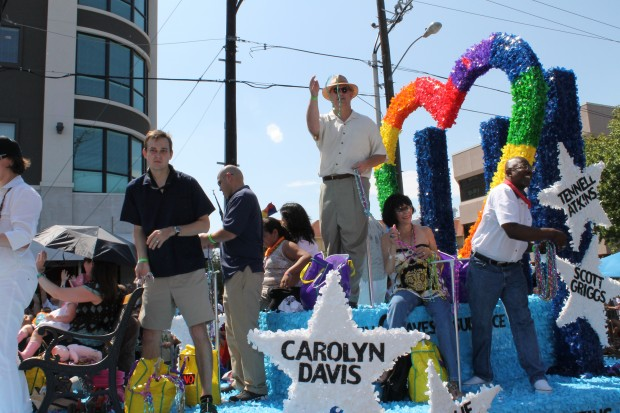 Mike Rawlings breaks me off some beads during last year's gay Pride parade.