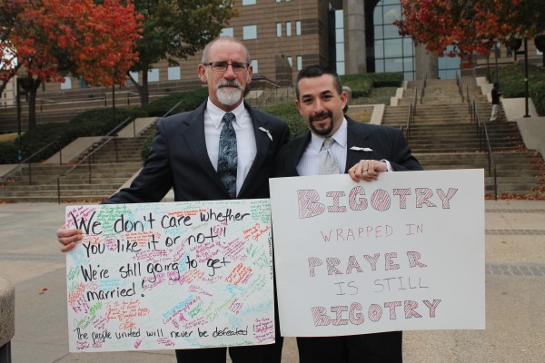 Charges dismissed against 1 of 2 gay Dallas men arrested at marriage sit-in