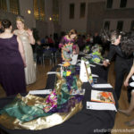 17_WM_Mardi_Gras_Masquerade_Women's_Chorus_of_Dallas_Inspecting_the_Silent_Auction_Copyright_2013_Patrick_Hoffman_All_Rights_Reserved