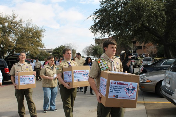 Gay Scouts and leaders deliver boxes with 1.4 million signatures from combined Change.org petitions requesting the Boy Scouts end its national no-gays ban on Feb. 4. BSA's Board of Directors is scheduled to vote on a policy change Feb. 6. (Anna Waugh/Dallas Voice)