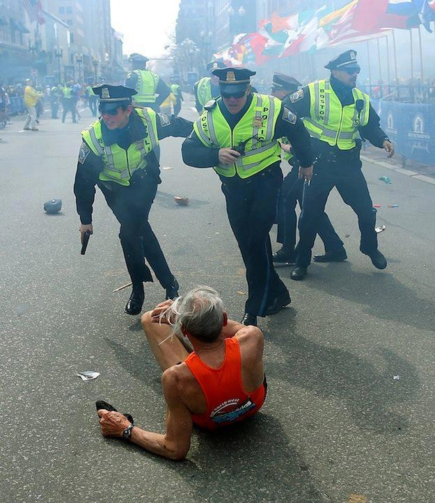 Gay police officer appears in iconic photo from Boston Marathon bombing
