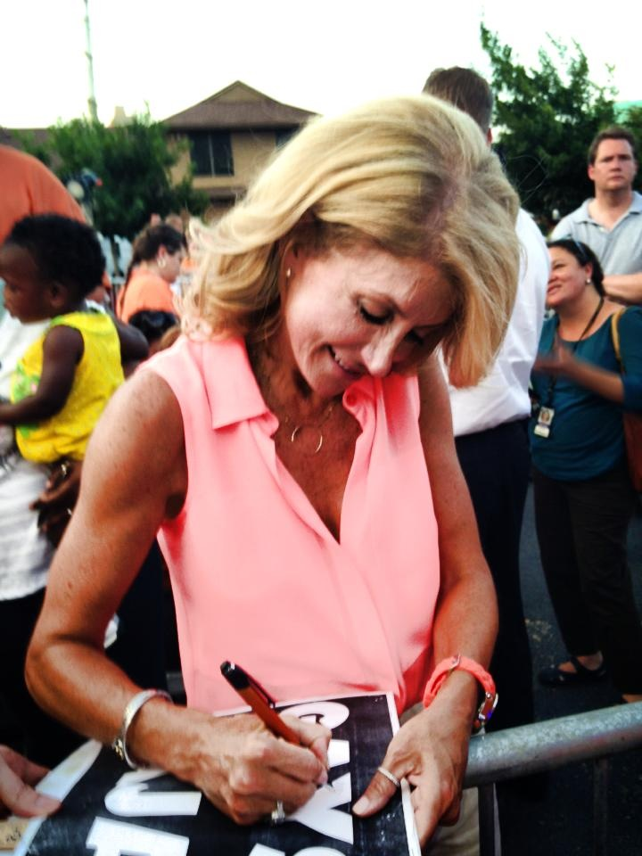 Wendy Davis signs Chance Browning's 'Gays for Vajays' sign