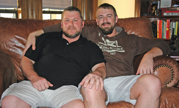 Michael Lovejoy and Graham Garrison kick back on one of the rare weekends where they have their home to themselves and aren't hosting a big gay pool party. (Photo by Rich Lopez)