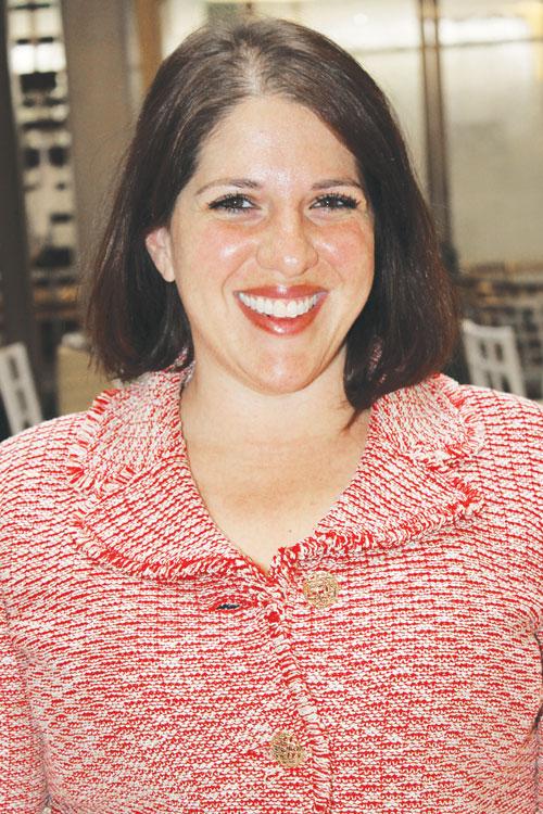 Maxey Scherr stands on her progressive record