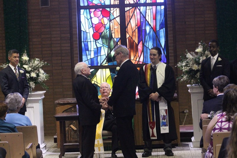 The Rev. Bill McElvaney marries Jack Evans and George Harris at Midway Hills Christian Church on March 1. (David Taffet/Dallas Voice)