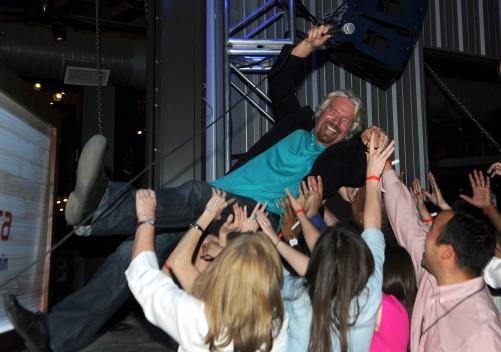 Richard Branson crowdsurfs for Virgin at Love