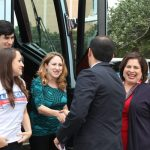 Leticia Van de Putte getting off the campaign bus with her family
