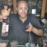 Zack-pouring-some-Stoli-at-Alexandres