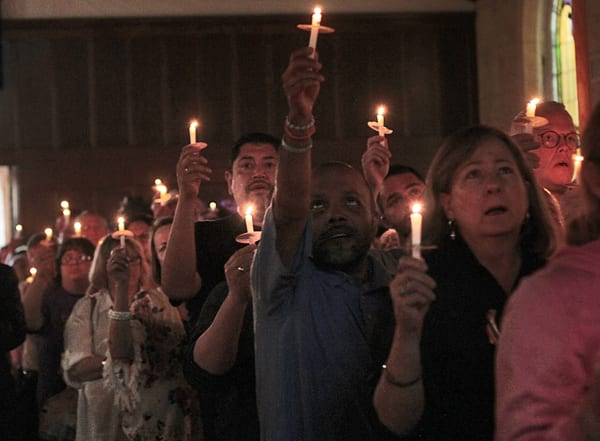 Grief, anger, vows to overcome at Fort Worth vigil for Orlando