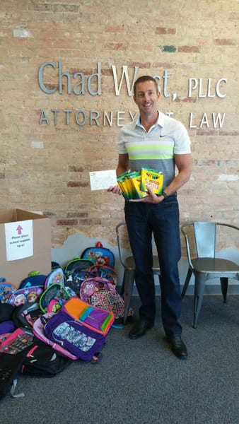 Chad West Law Firm holds Crayons for Kids school supply drive