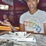 Woodys---Jonah-looking-at-his-oragami-tips