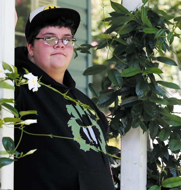 FILE - In this Aug. 25, 2015, file photo, Gavin Grimm poses on his front porch during an interview at his home in Gloucester, Va. The fate of North Carolina's new bathroom law could be determined by the 4th U.S. Circuit Court of Appeals in Richmond, which is expected to rule soon on Grimm's challenge. The high school student was born female but identifies as male, and says it's discriminatory to make him use the girls' room or a single-stall unisex restroom. (AP Photo/Steve Helber, File)