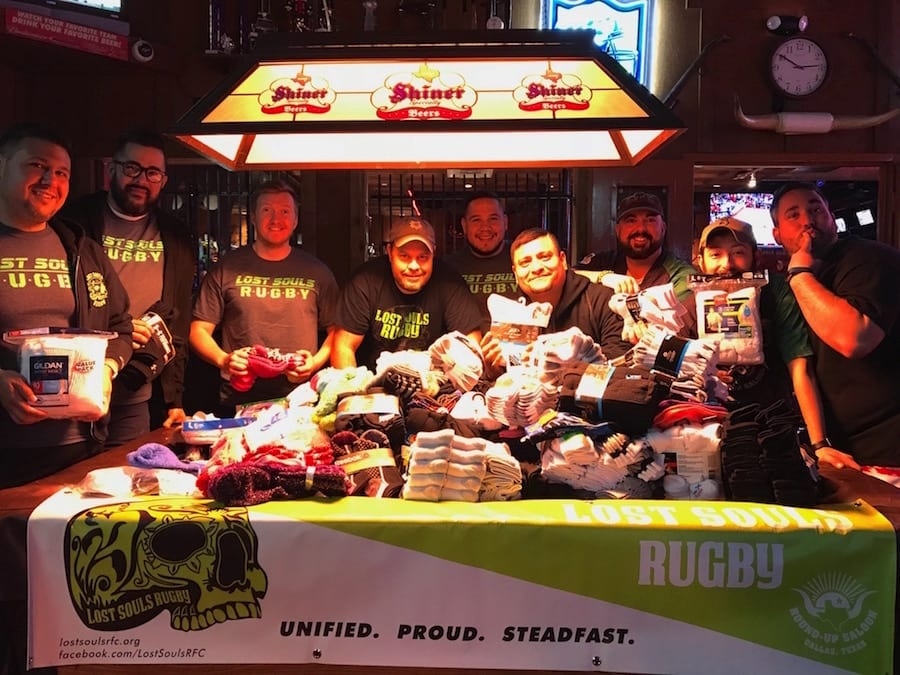 Rugby team collects socks for homeless teens