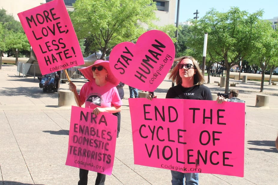 Protesters and counter-protesters mark the NRA's convention in Dallas