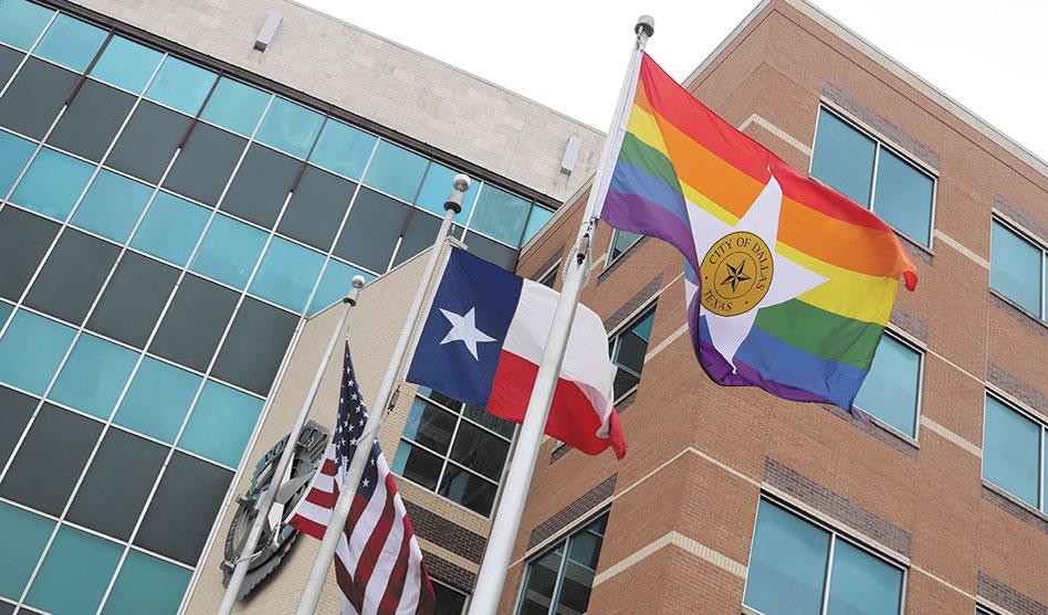 Dallas Pride flags fly over city facilities